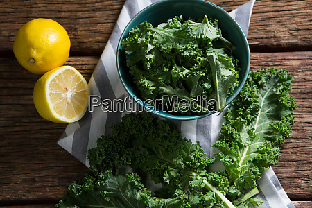 mustard greens and lemon on wooden