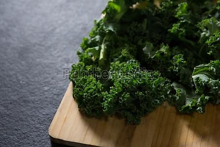 mustard greens on chopping board