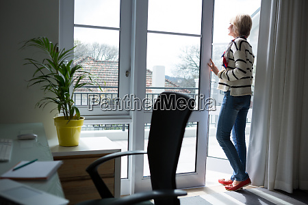 woman standing at home