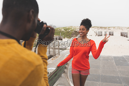 man capturing photo of woman while