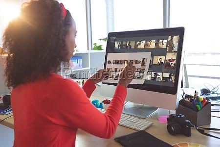 female graphic designer looking photographs