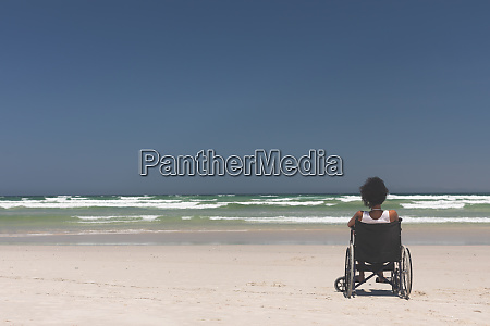 young woman disable sitting on wheelchair
