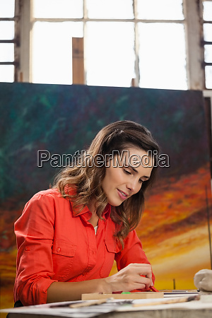 woman painting a sketch