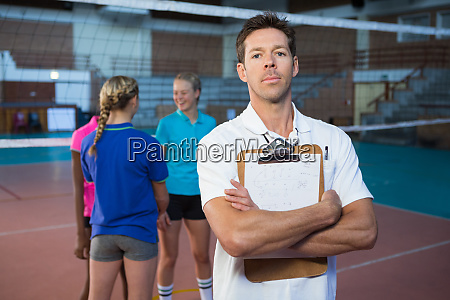 confidence male coach standing in the