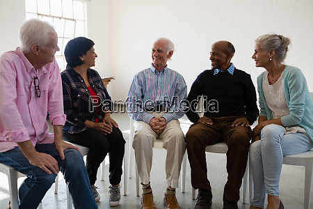 friends talking during discussion in art