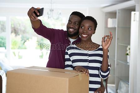couple showing house key while taking