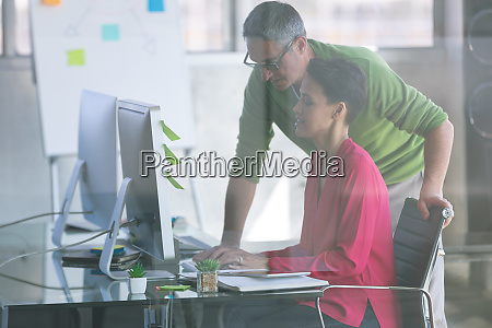 attentive business people working at desk