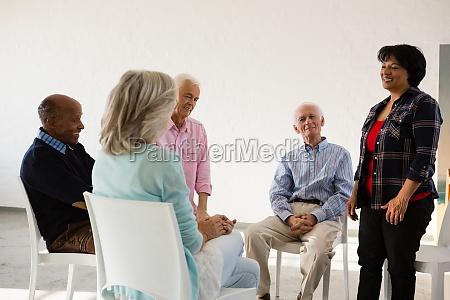 woman talking to friends sitting on