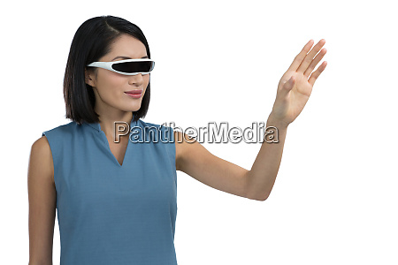 female executive gesturing while using virtual