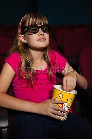 girl wearing 3d glasses while having