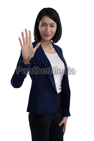 businesswoman touching invisible screen