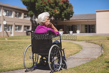 senior woman relaxing on wheelchair at