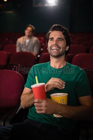 man watching movie in theatre