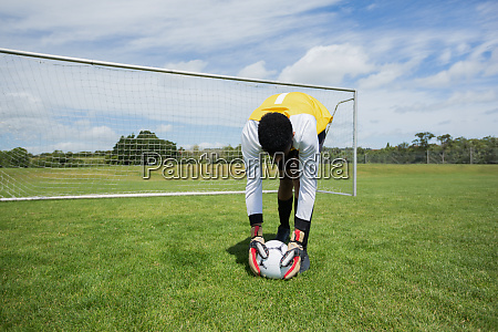 goalkeeper ready to kick the soccer