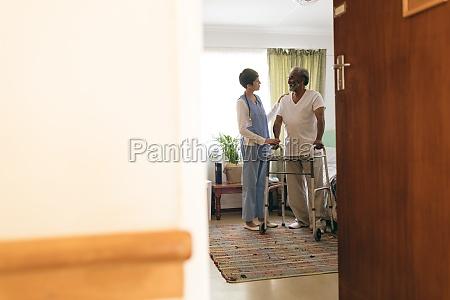 female nurse talking with senior man