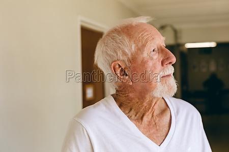 senior male patient standing at retirement