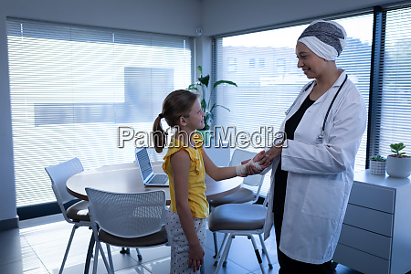 matured female doctor interacting and examining