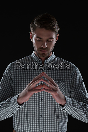 man pretending to hold an invisible
