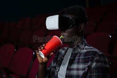 man using virtual reality headset while