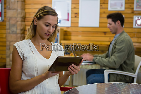 young woman with tablet while young