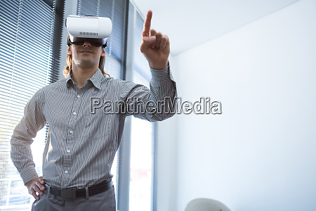 male executive gesturing while using virtual