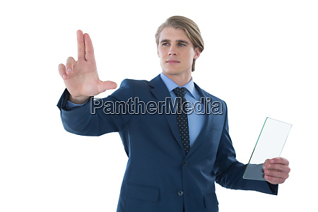 confident businessman holding glass interface while
