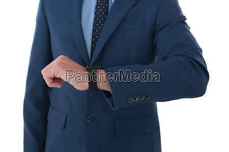 mid section of businessman wearing wrist