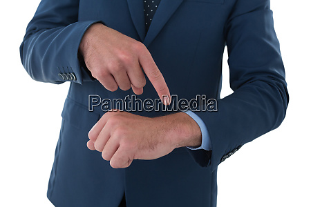 mid section of businessman pointing on