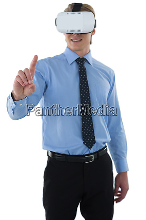 young businessman gesturing using wearable computer