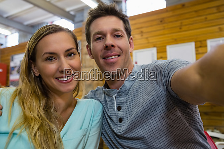 portrait of couple sitting in cafe