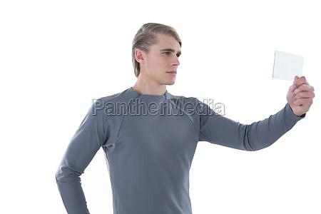 businessman holding transparent glass interface