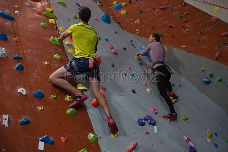 athletes rock climbing in fitness studio