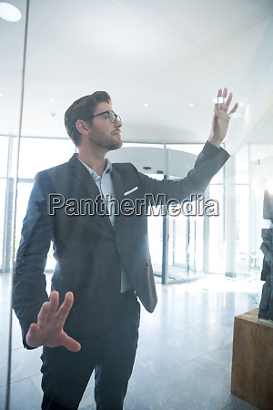 businessman touching invisible digital screen