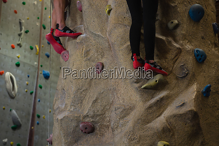 low section of athletes rock climbing