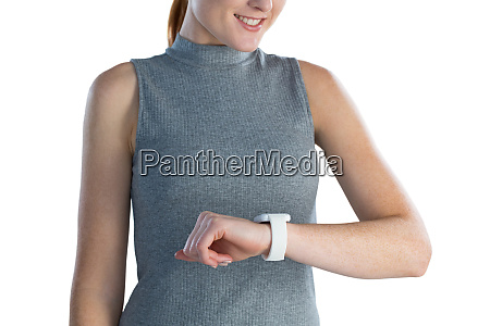 mid section of businesswoman looking at