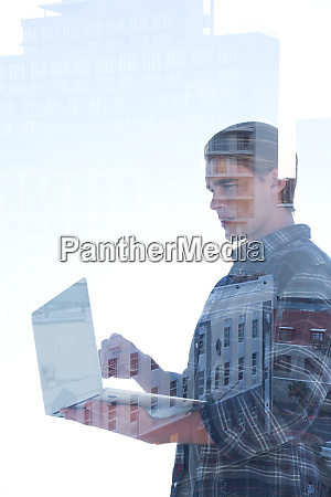 side view of businessman using laptop