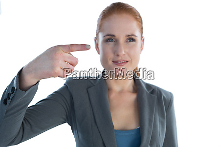 smiling businesswoman looking away while gesturing