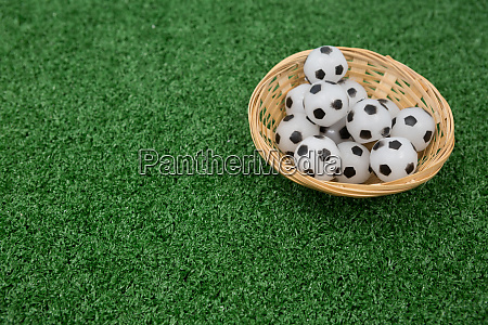 footballs in wicker basket