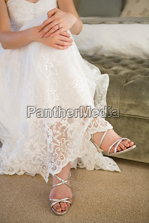 low section of bride wearing silver