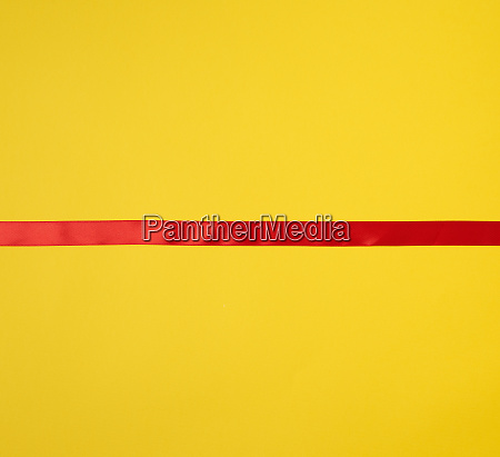 red silk ribbon on a yellow