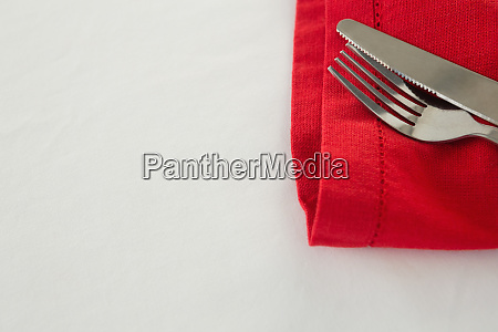 fork and butter knife with napkin