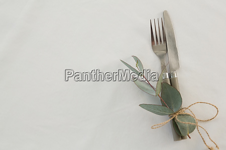 fork and butter knife tied with