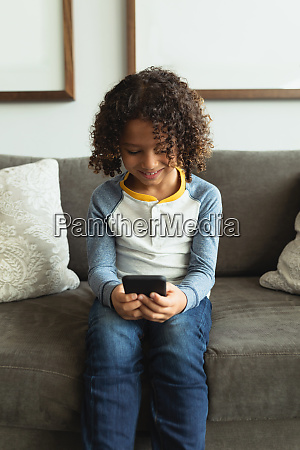 boy using mobile phone in the