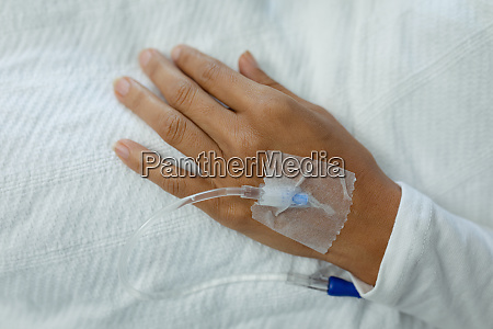 iv drip on a patient hand