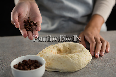 woman adding chocolate chips into the