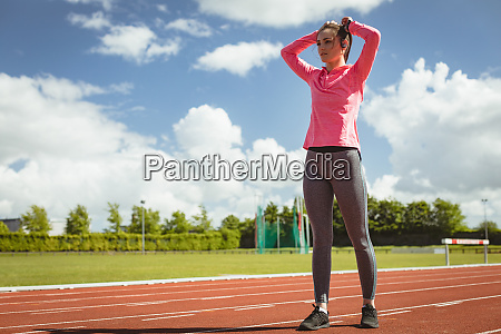 woman standing on a race track