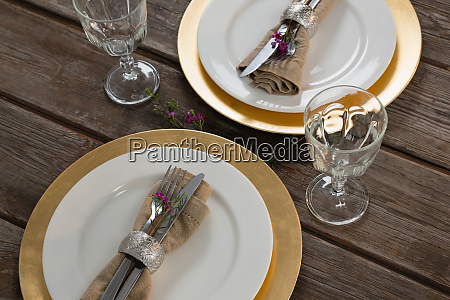 elegance table setting on wooden plank