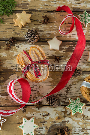 cookies and christmas decoration on wooden