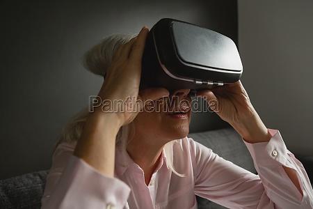 active senior woman using virtual reality