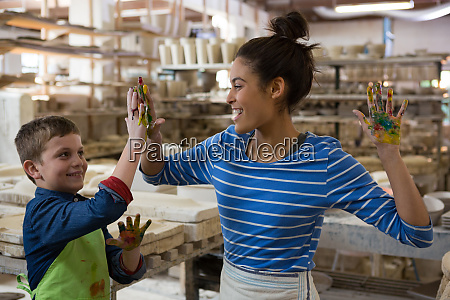 mother and son giving high five
